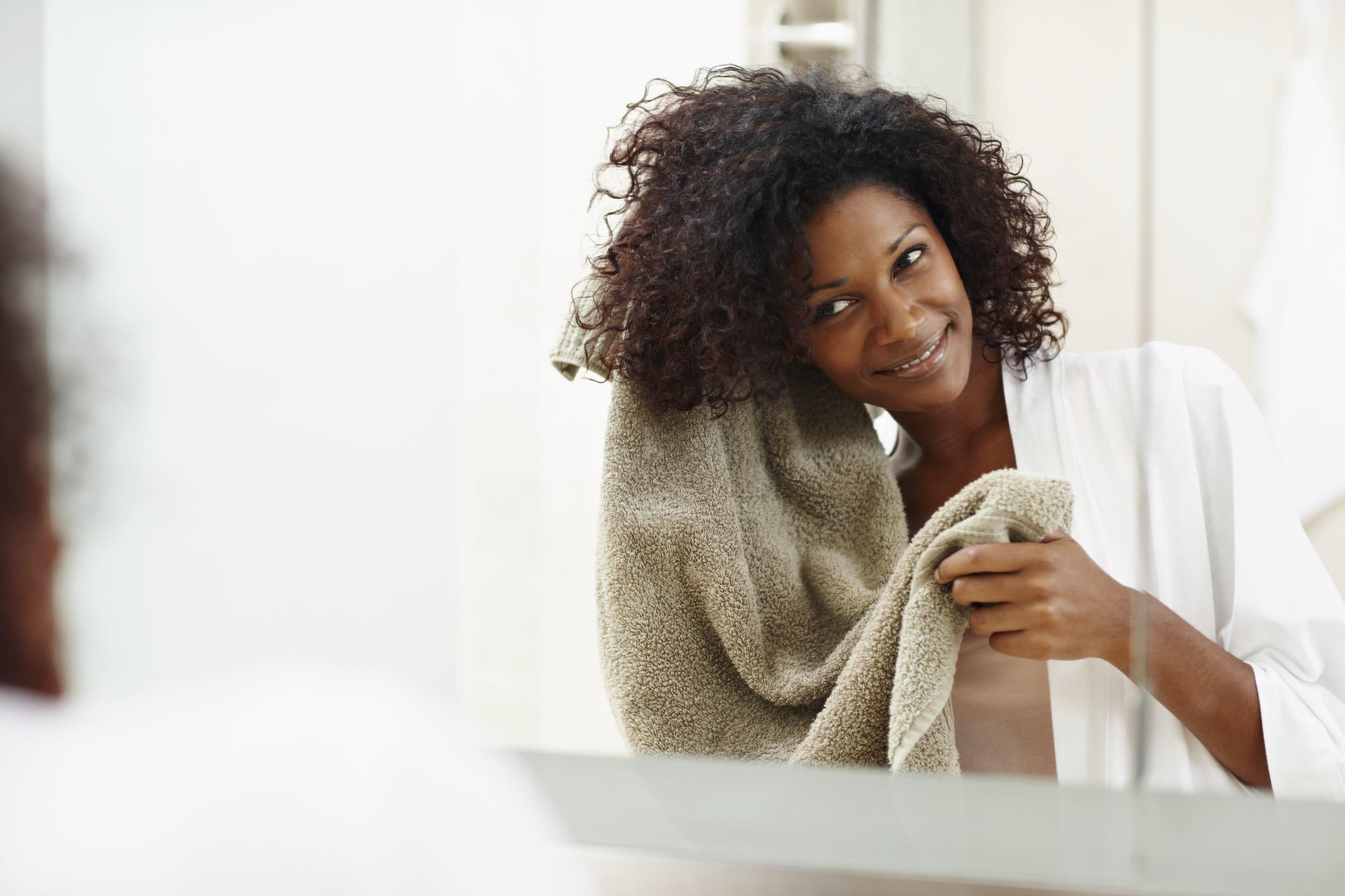 Shampoo: All Things Hair - IMAGE -Black woman drying her natural hair