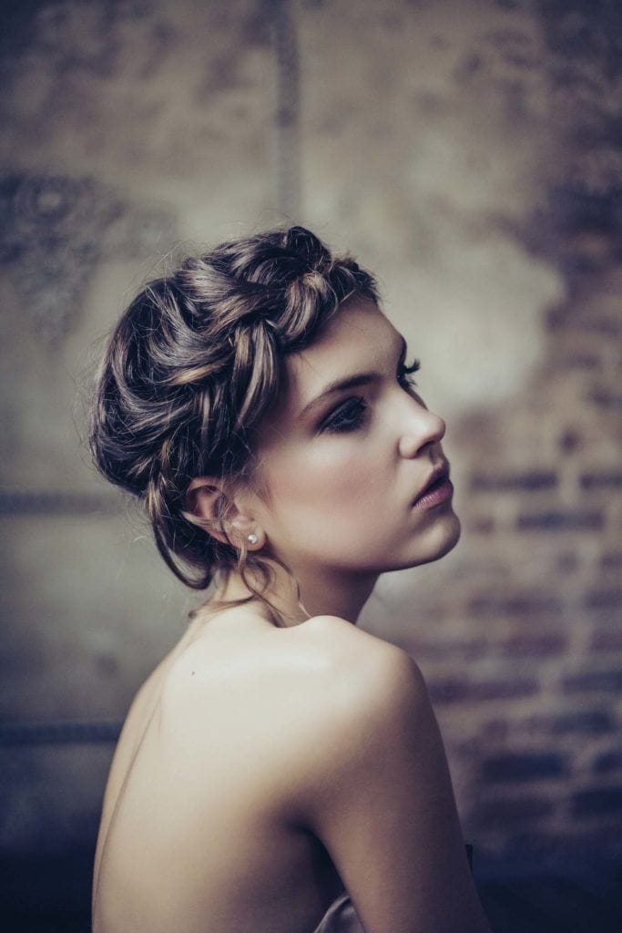 Halo braid styles: the messy halo braid in brown hair