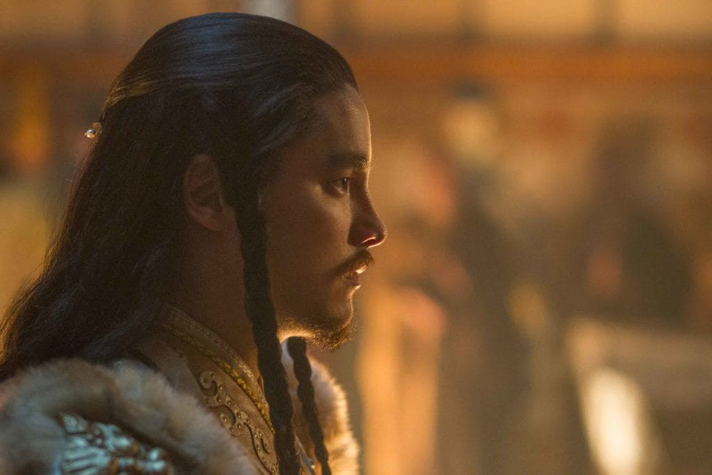 side view of a man from Marco Polo tv show wearing double braids in dark hair