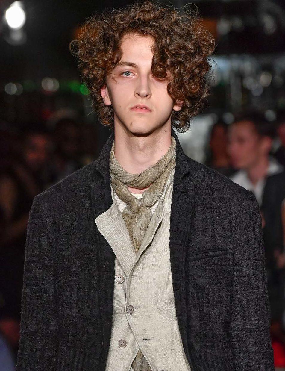 Permed hair: All Things Hair - IMAGE - man with medium brown curly hair