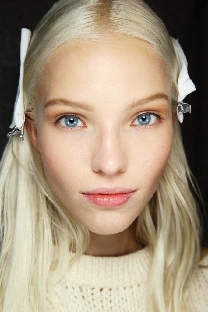 Close-up of model Sasha Luss model with blonde white hair