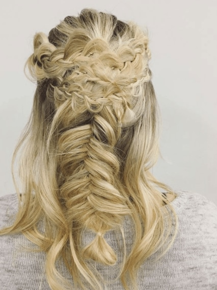 Fishtail braids: Woman with blonde hair styled with multiple braids