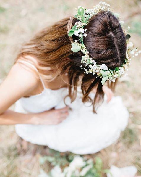 Brunette woman with white vinok-inspired flower crown wearing a wedding dress