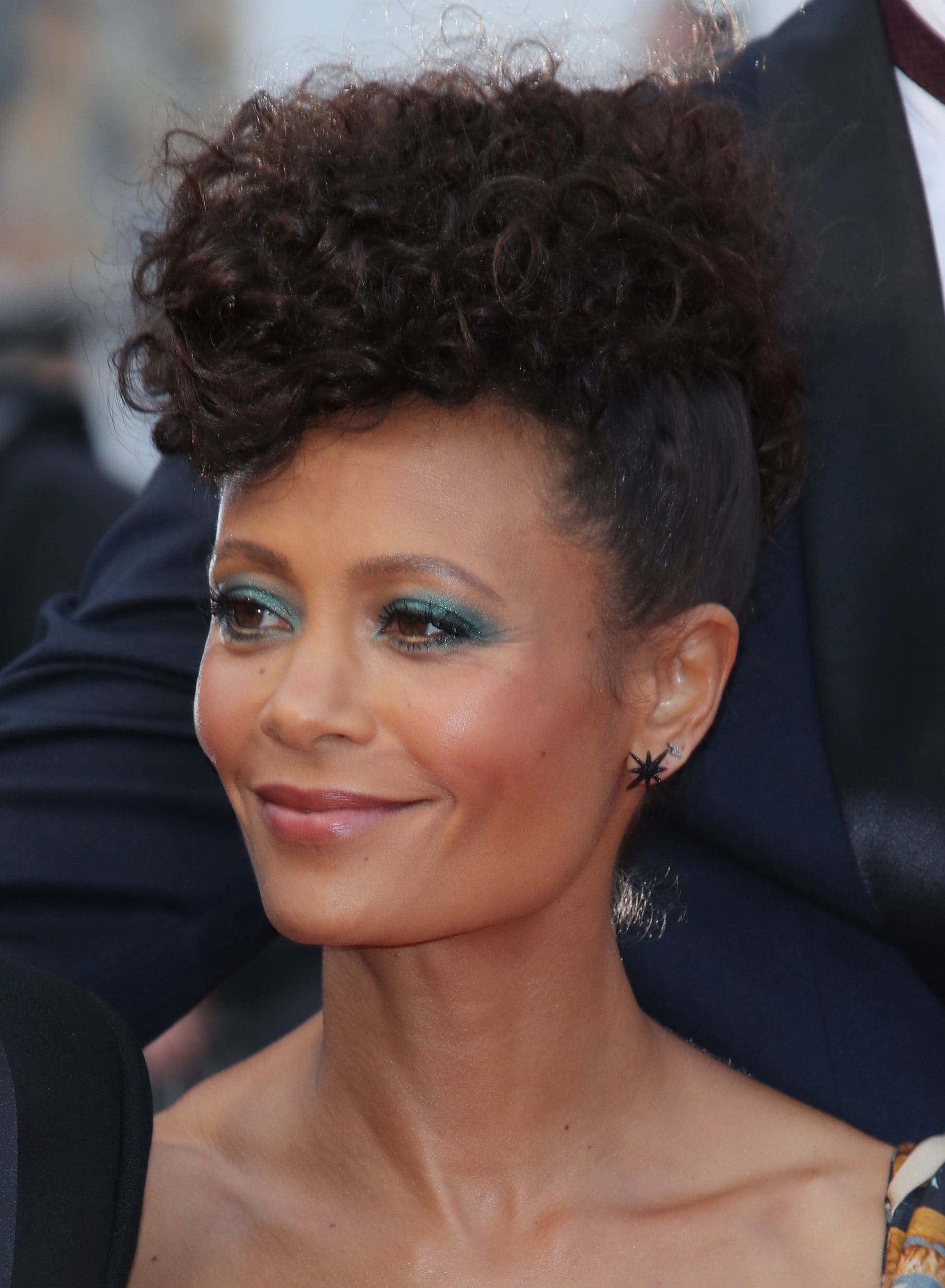 Curly hair hairstyles: Thandie Newton with dark brown naturally curly hair styled in a frohawk