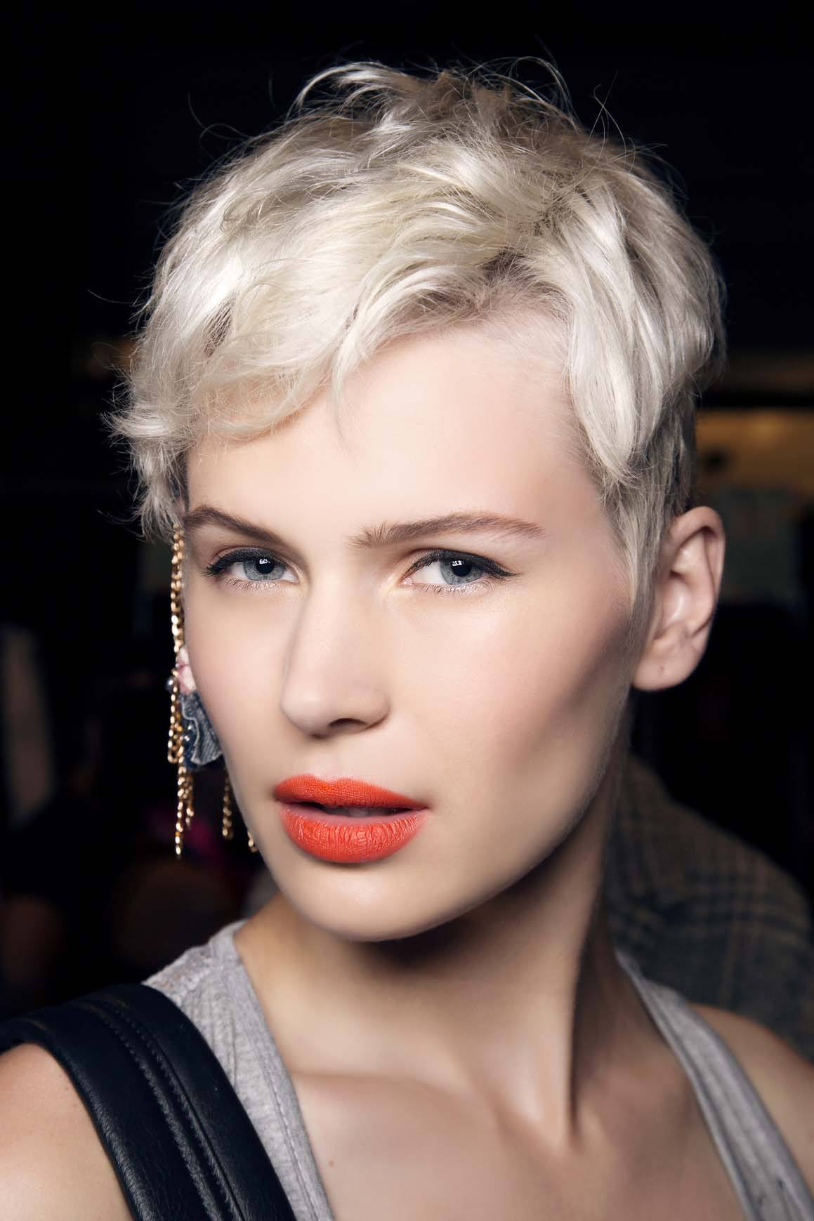best short haircuts for women: model with platinum blonde pixie hair