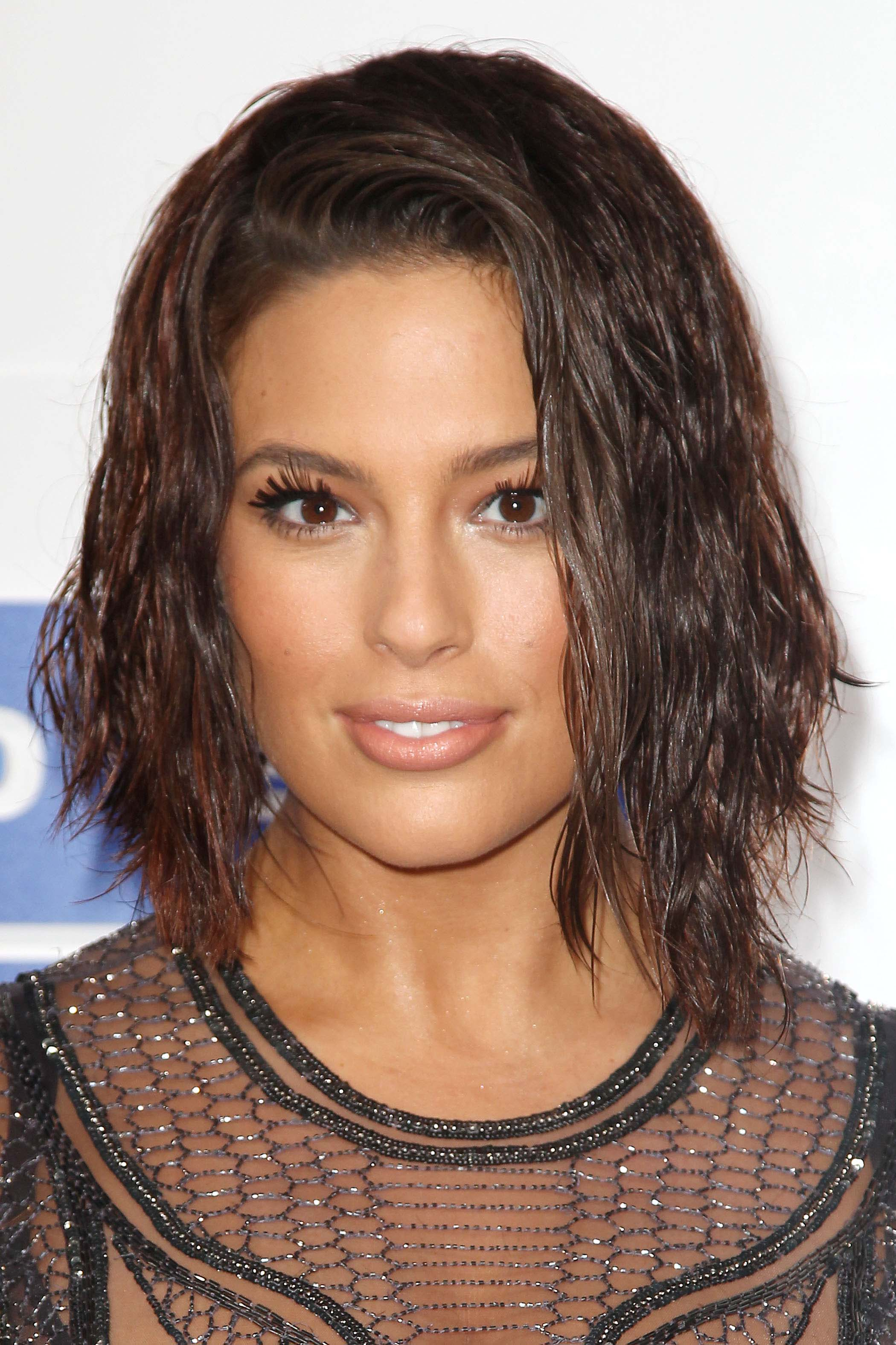 close up shot of Ashley Graham with wet look brunette bob on the red carpet