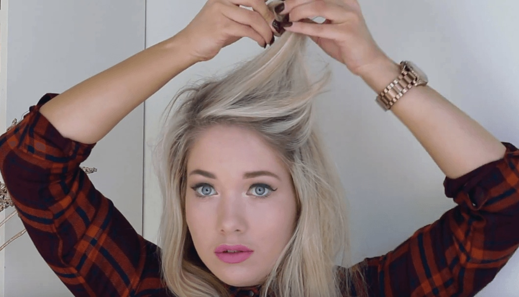 Pin up hairstyles: Blonde blogger Away With The Fairies holding up the top layer of her hair