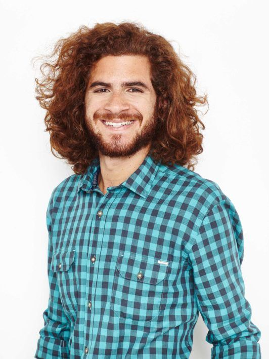 man with curly brown hair