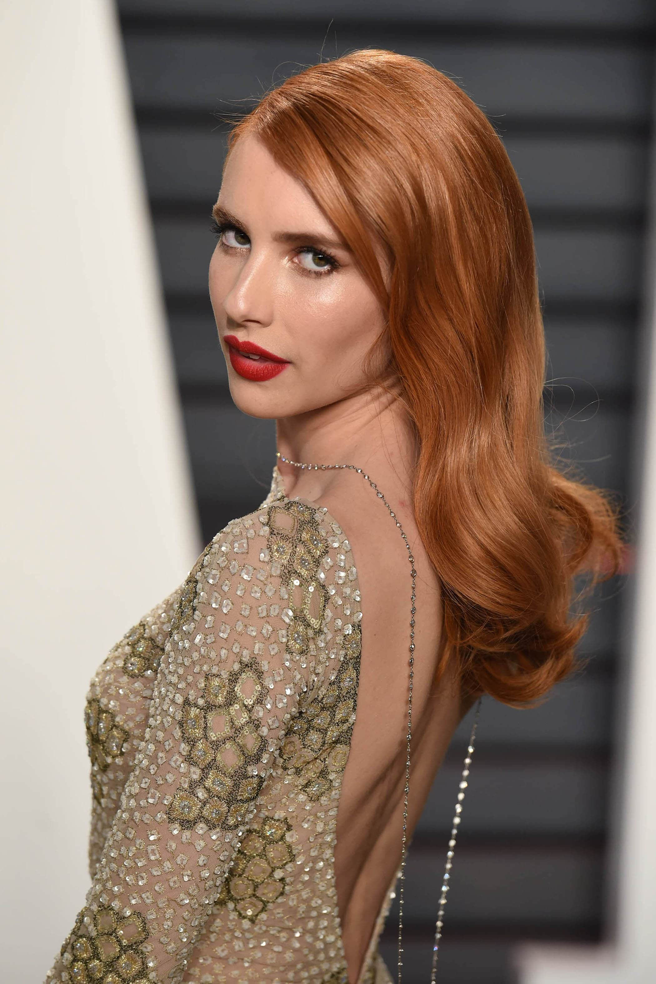 Red carpet hairstyles: Emma Roberts fiery red hair colour with loose curls Oscars 2017