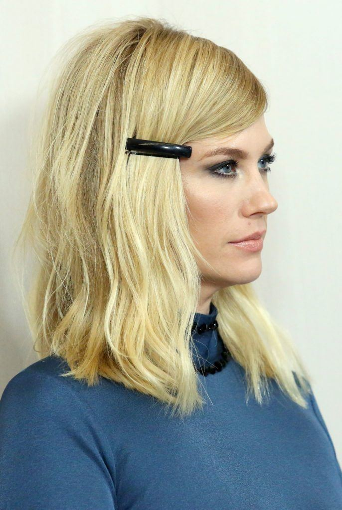 January Jones with blonde hair and a long bob with a hair clip