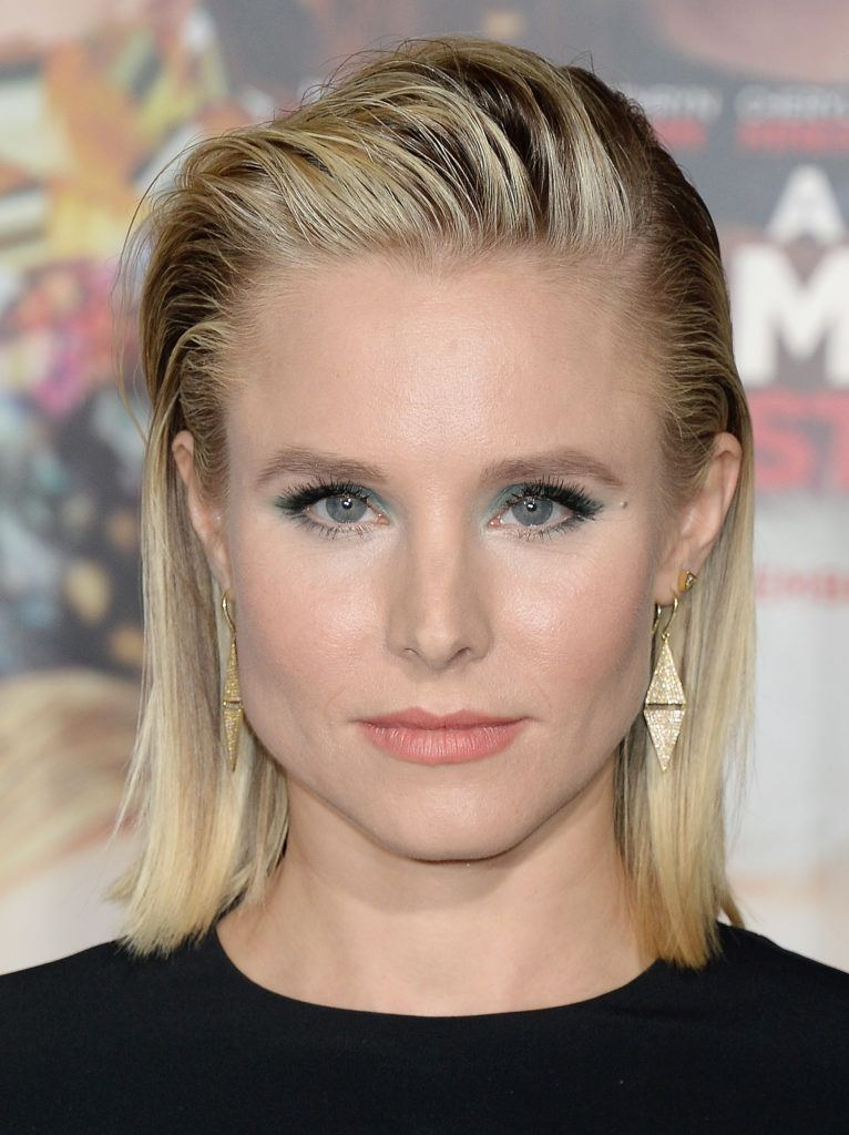 Kristen Bell with blonde hair slicked back in a long bob hairstyle