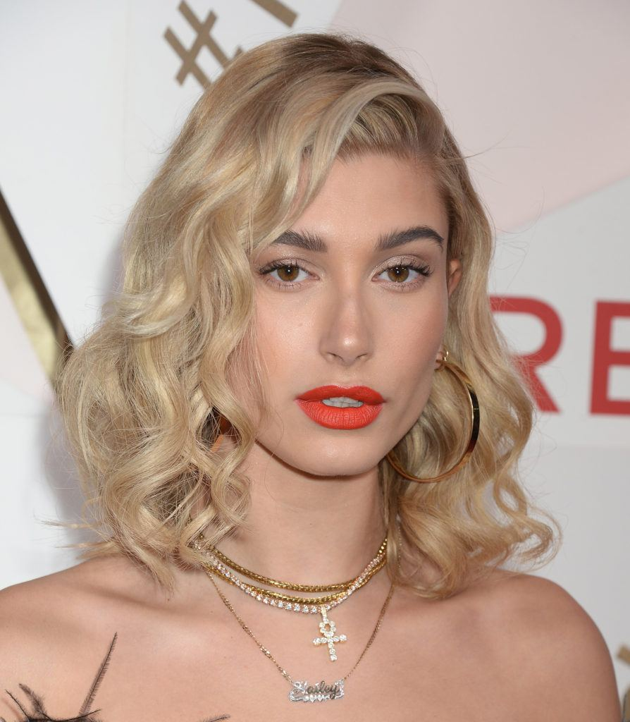 Hailey Baldwin with blonde hair in a bob hairstyles in waves