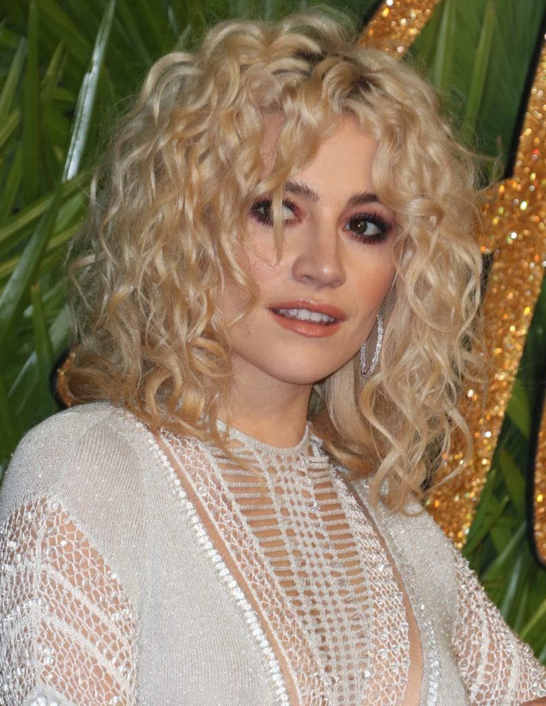 Pixie Lott with blonde curls in a long bob style