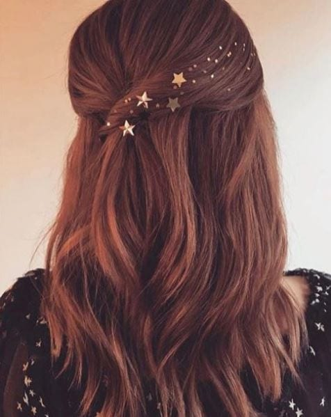 back view of brown long wavy hair with star hair accessories pinned back hair
