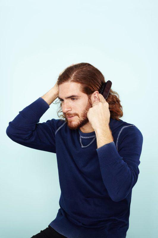 man bun hairstyle: All Things Hair - IMAGE - mens hairstyle brushing hair