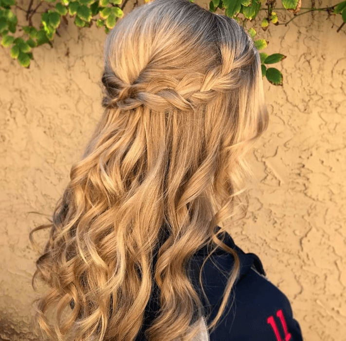 girl with blonde curly hair with side braid