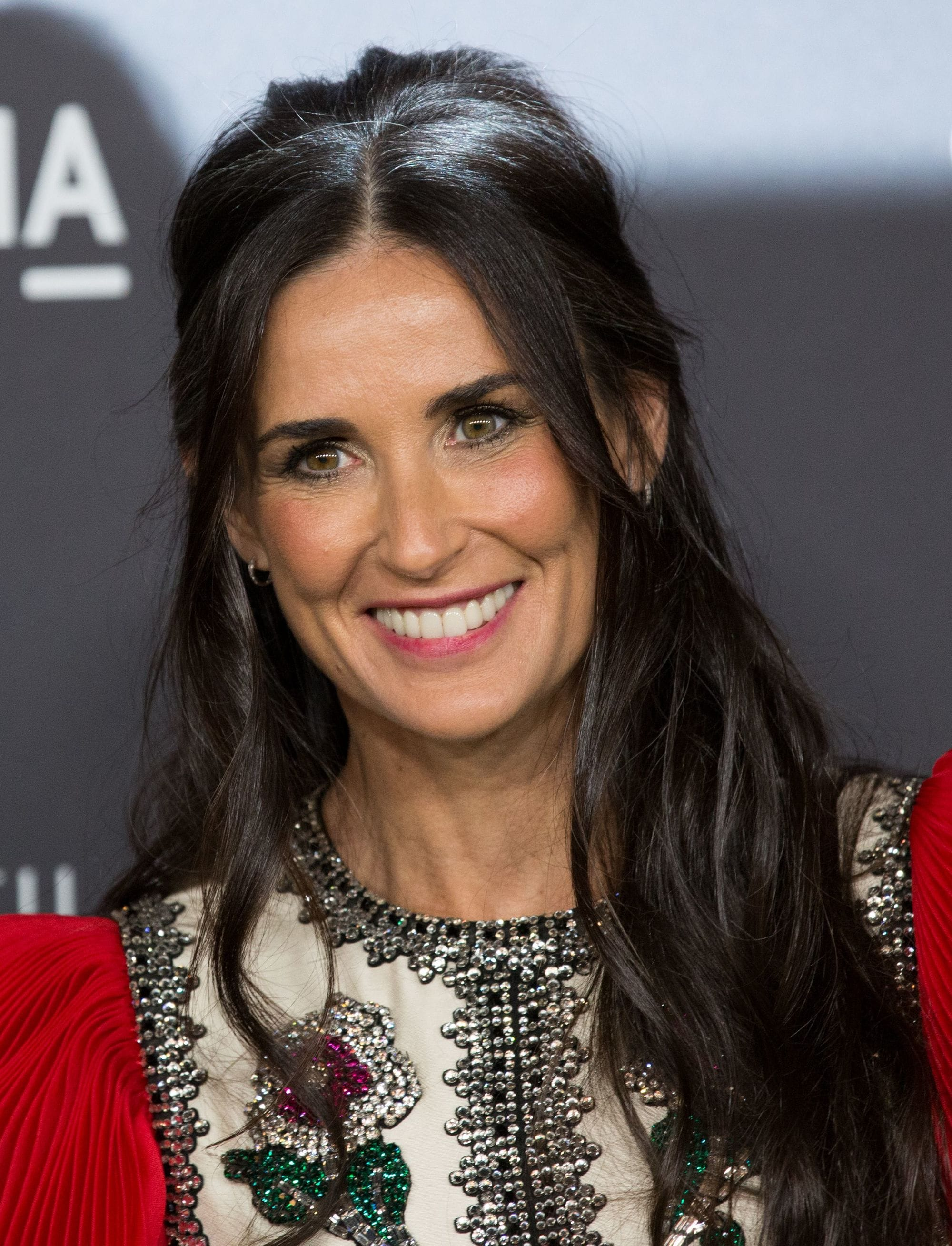 Demi Moore with half-up hair ageless hairstyles over 50