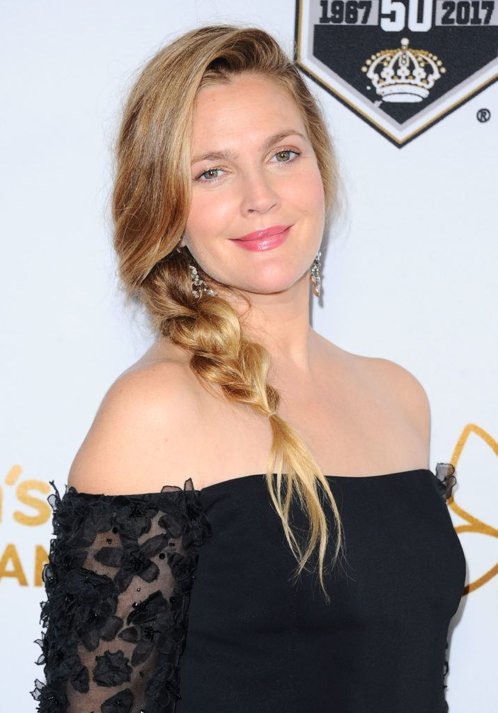 drew barrymore with blonde hair wearing a low loose braid