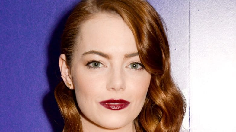 Emma Stone with Hollywood waves red bronze hair