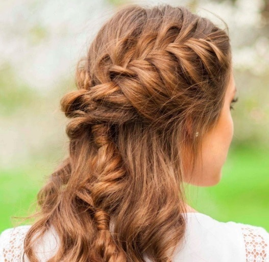 back view of a woman with brown hair in a braid