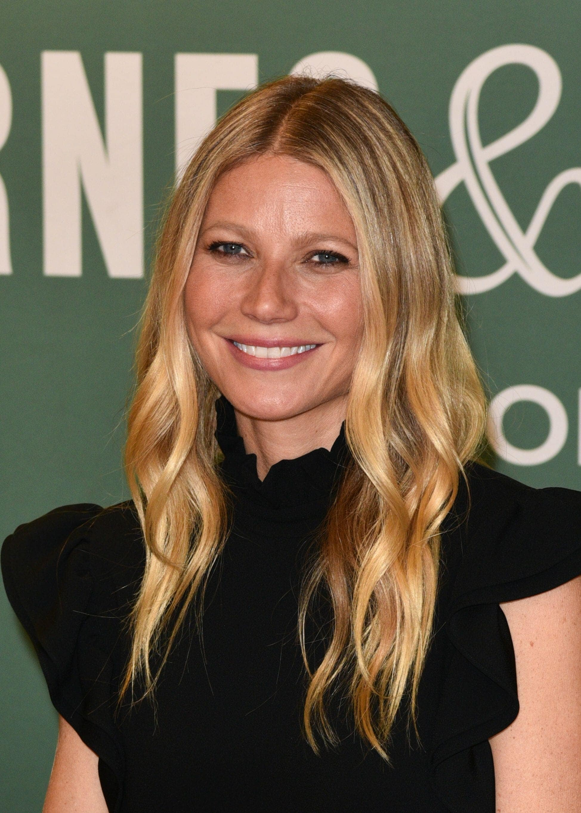 Gwyneth Paltrow with curly hair in a black dress hairstyles for very fine hair