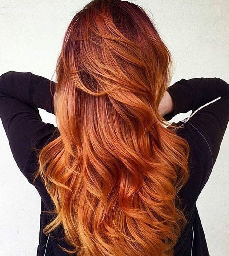 Woman with long ginger hair hygge trend