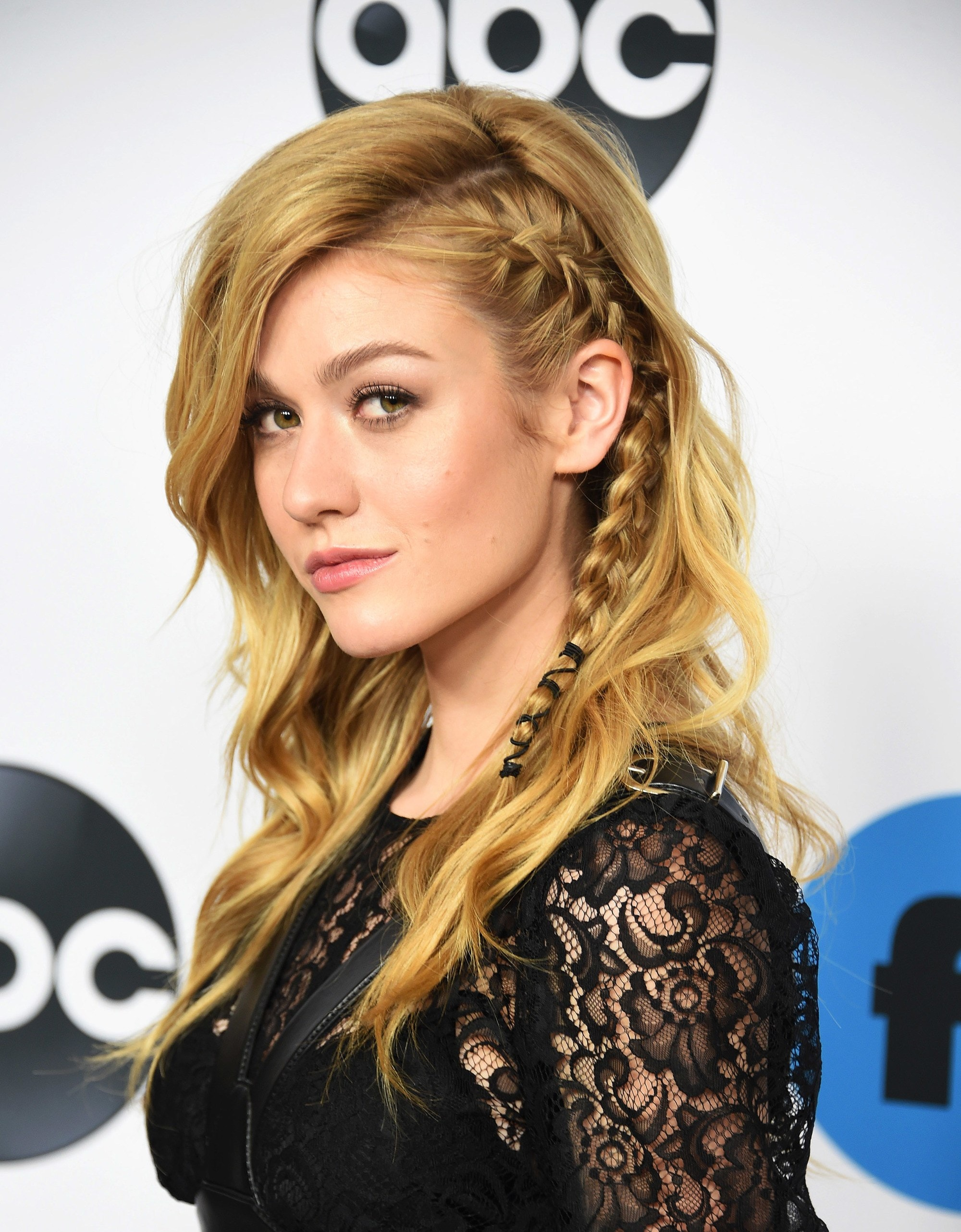 Side hairstyles: Katherine McNamara with golden blonde hair in a side undercut braided style with waves