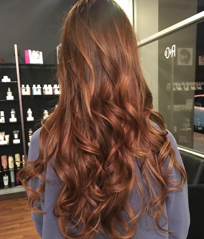 Woman with curly auburn hair hygge trend
