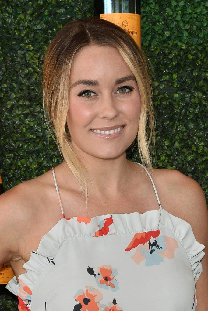 Lauren Conrad with medium brown hair with highlights in a floral dress