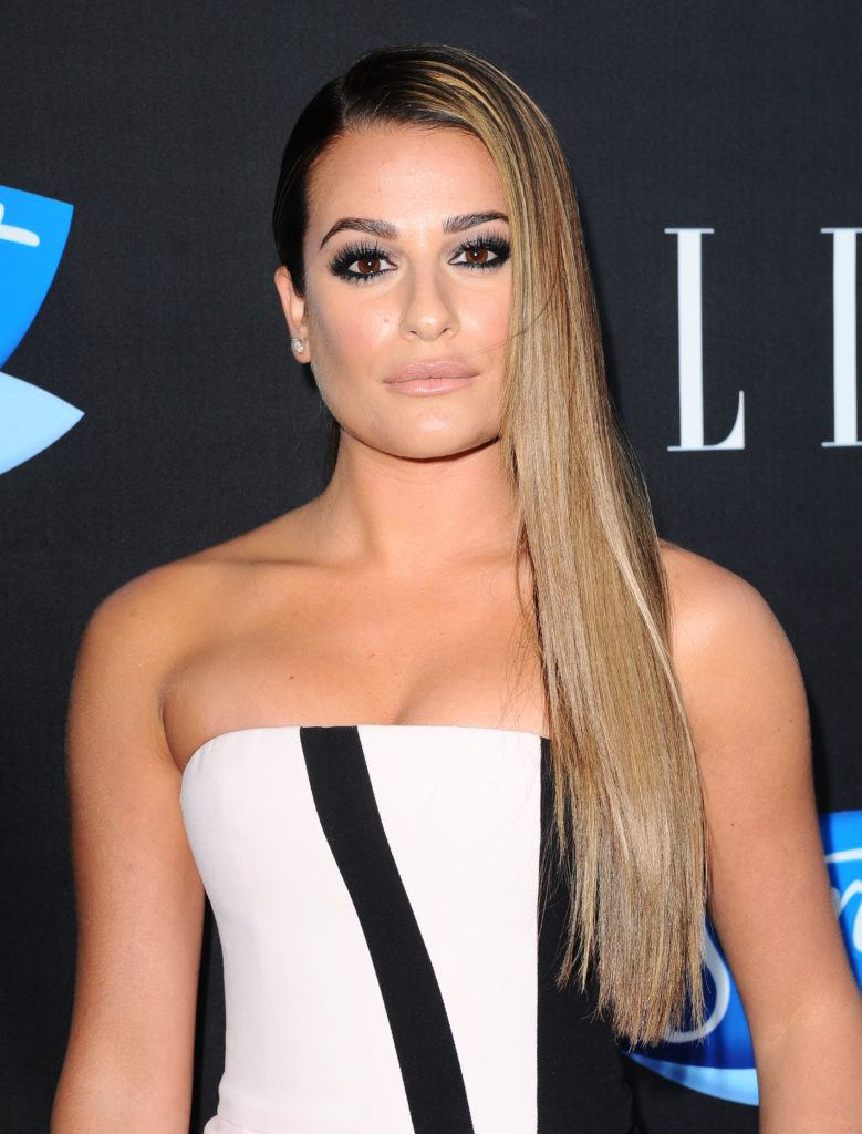 lea michele with long balayage hair in a side sweep