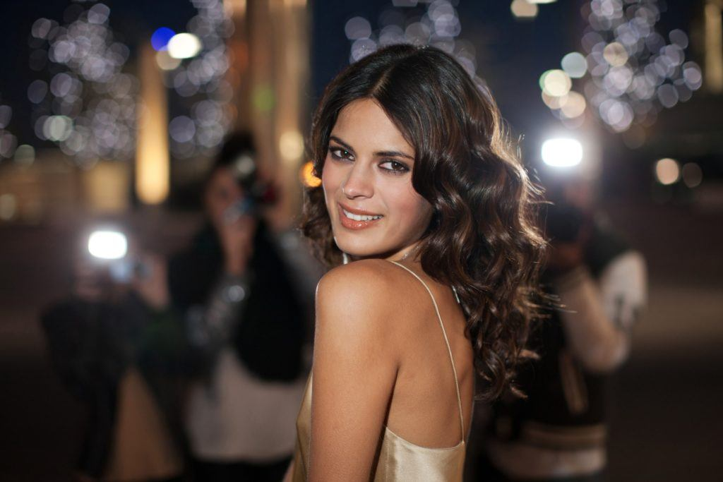 close up of model with long curls at a party