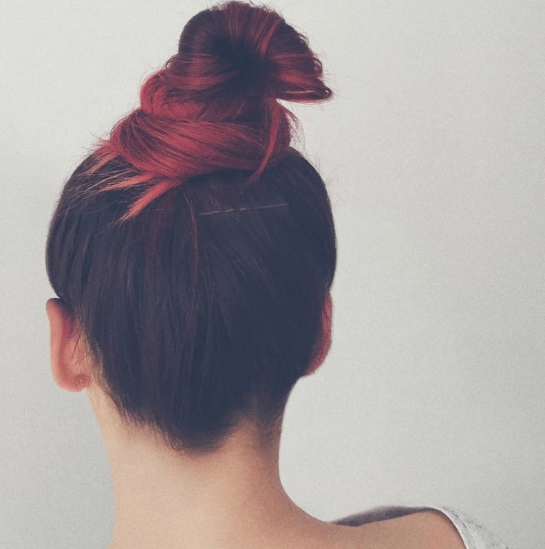 a woman with a ombre hair in a top knot style