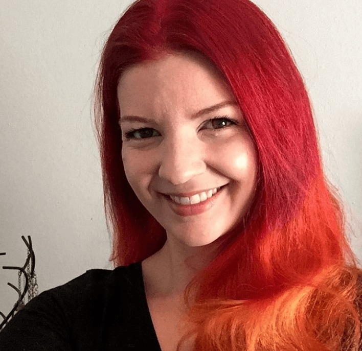 woman with bright red hair with orange ombre