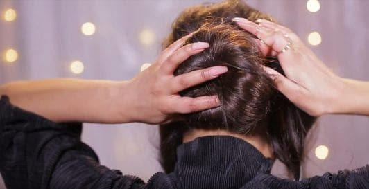 N1kk1sSecr3t putting hair into bun
