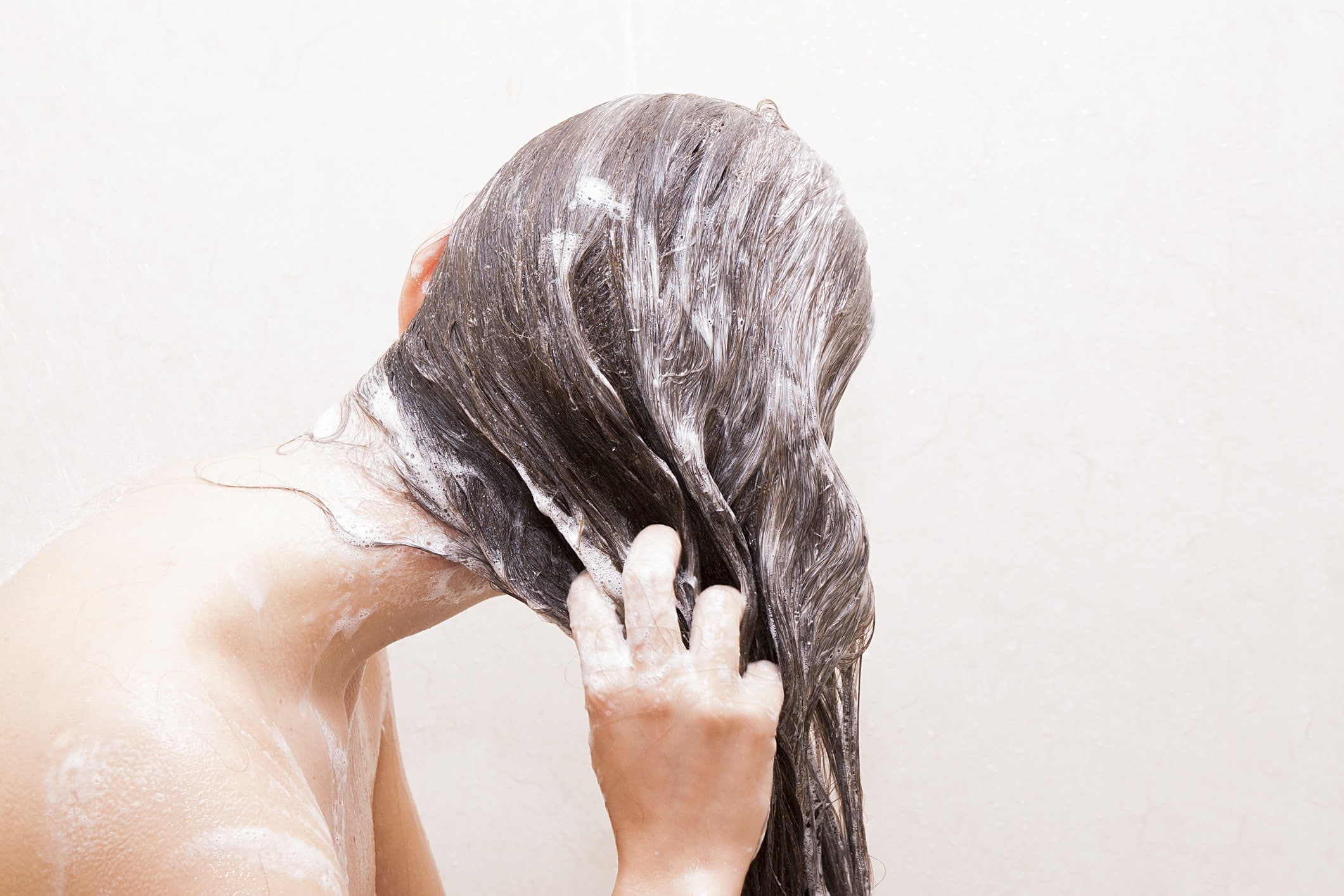 is dry shampoo bad for your hair women washing her long brown hair before curling long hair