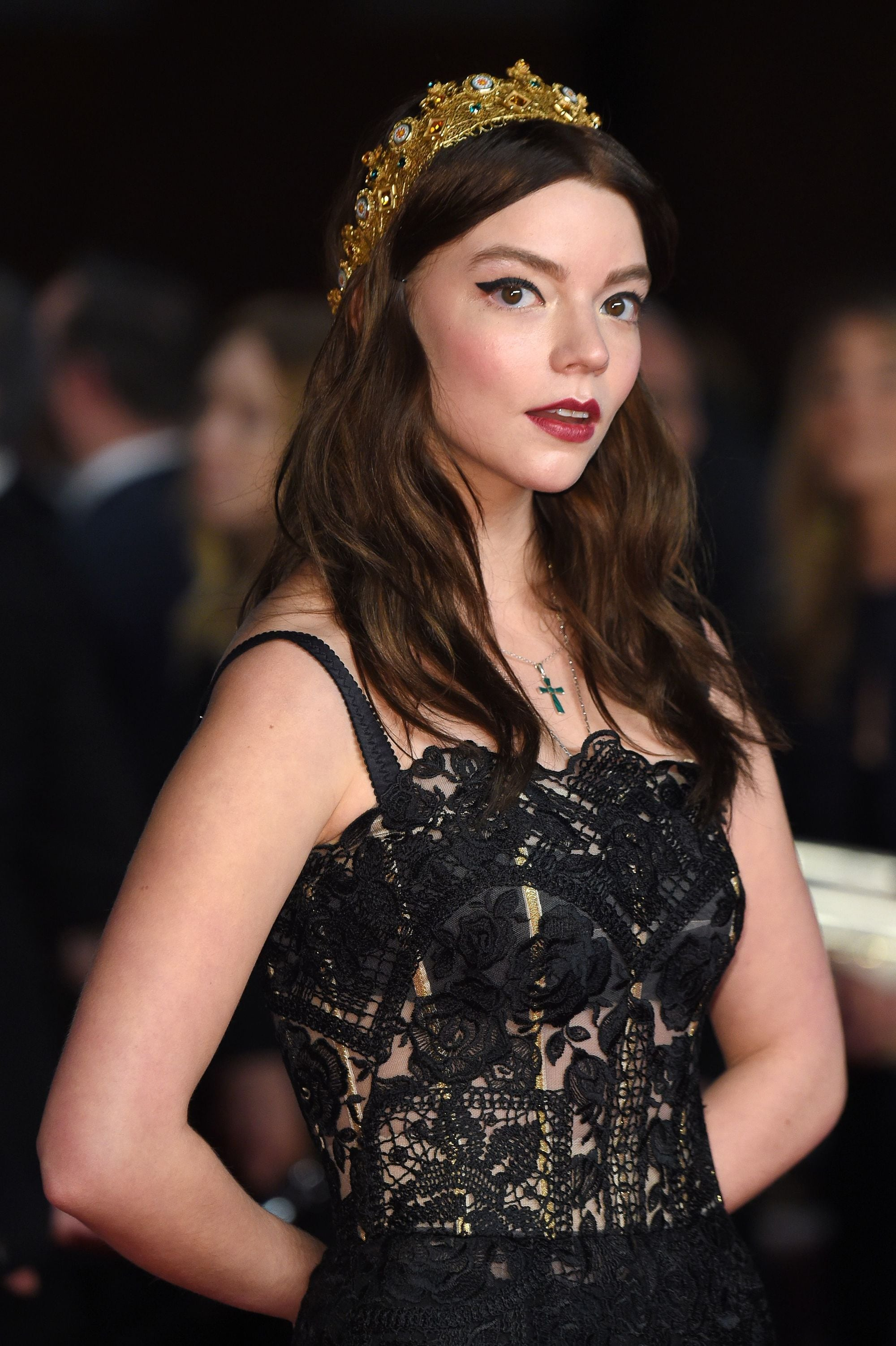 Anya Taylor-Joy medium length dark brown wavy hair with gold crown headpiece