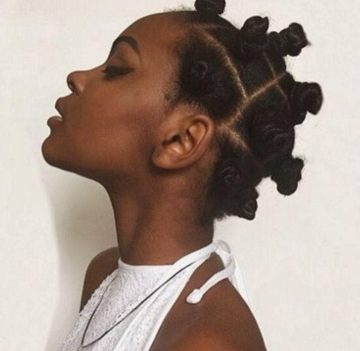 woman with bantu knot hairstyle workout hairstyles for black hair