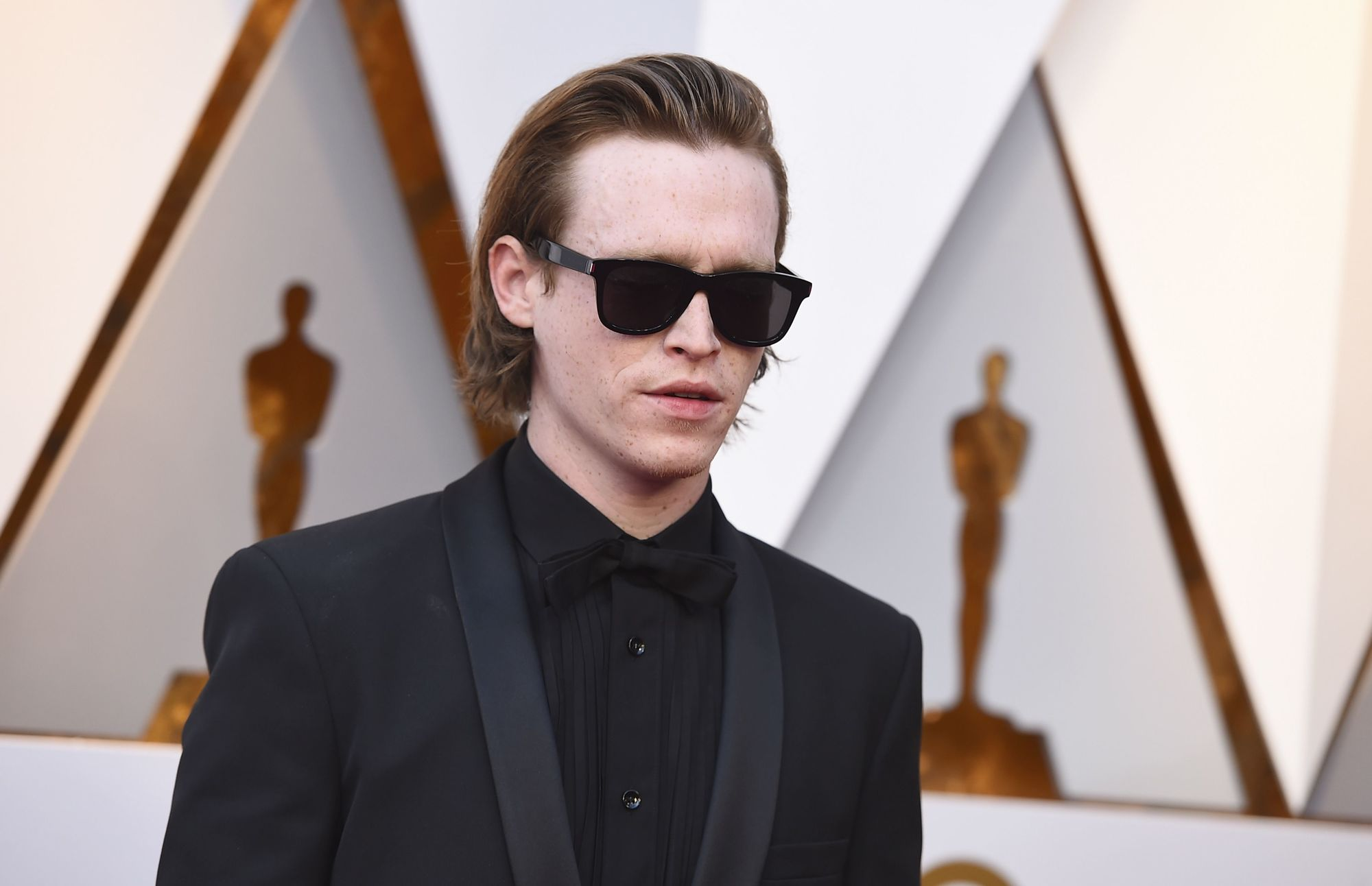 close up shot of caleb landry wearing swept back hairstyle, black suit jacket at the 90th Academy Awards