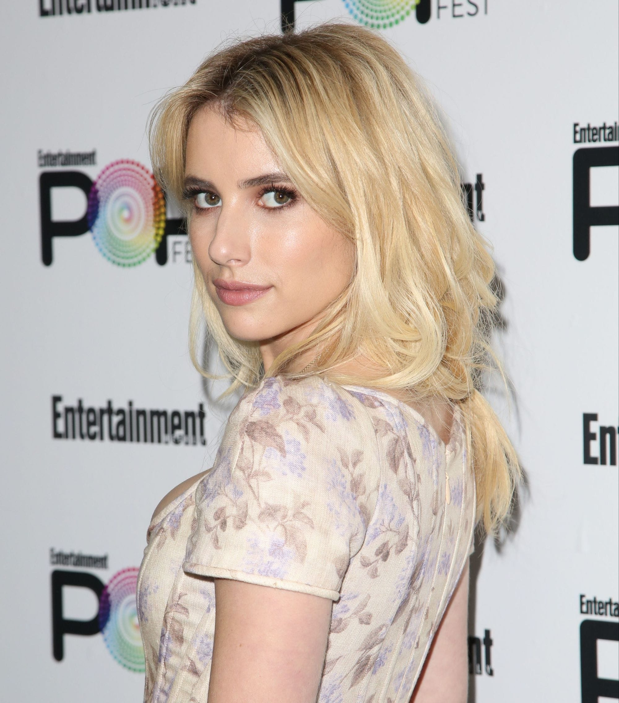 emma roberts wearing a floral dress with bleached blonde long hair