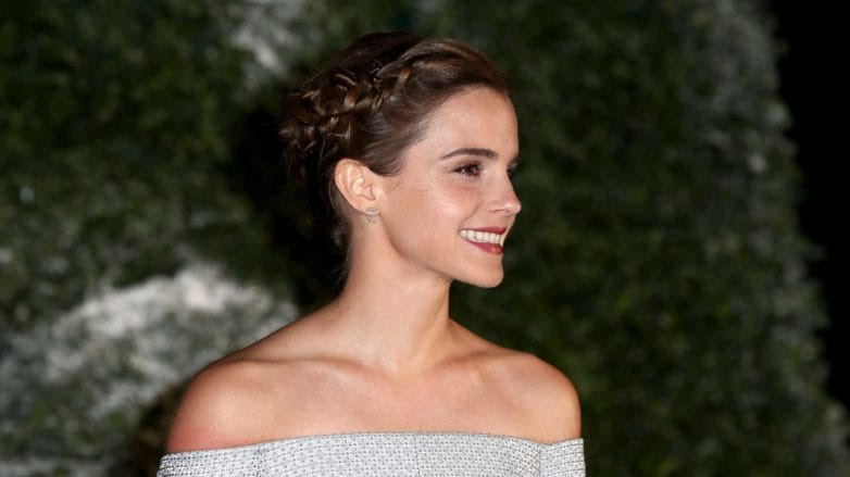 Emma Watson with a plaited updo in her brunette hair on the red caret wearing a pale blue gown