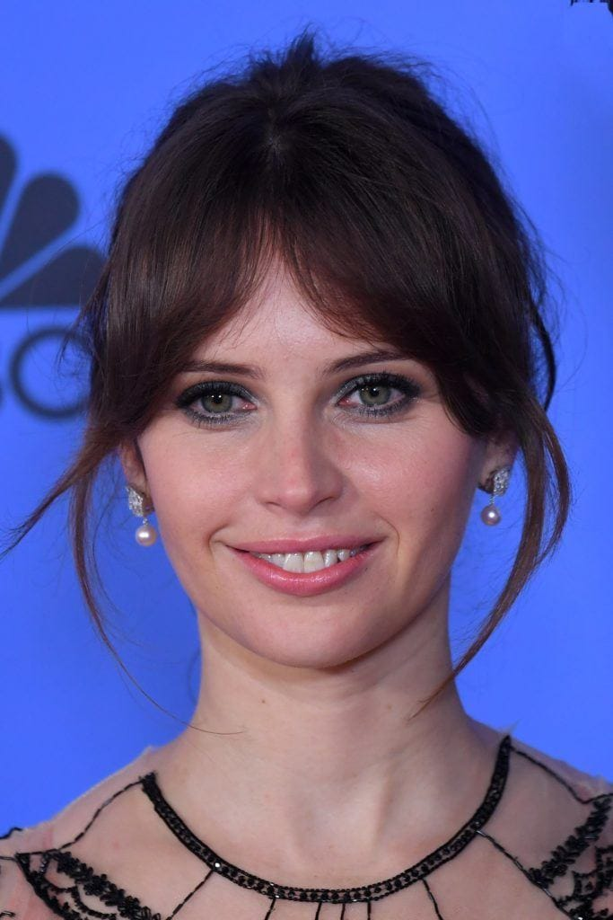 picture of Felicity Jones with brown hair in an updo with a fringe