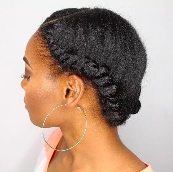 side view of a woman with her hair up - flat twist hairstyles