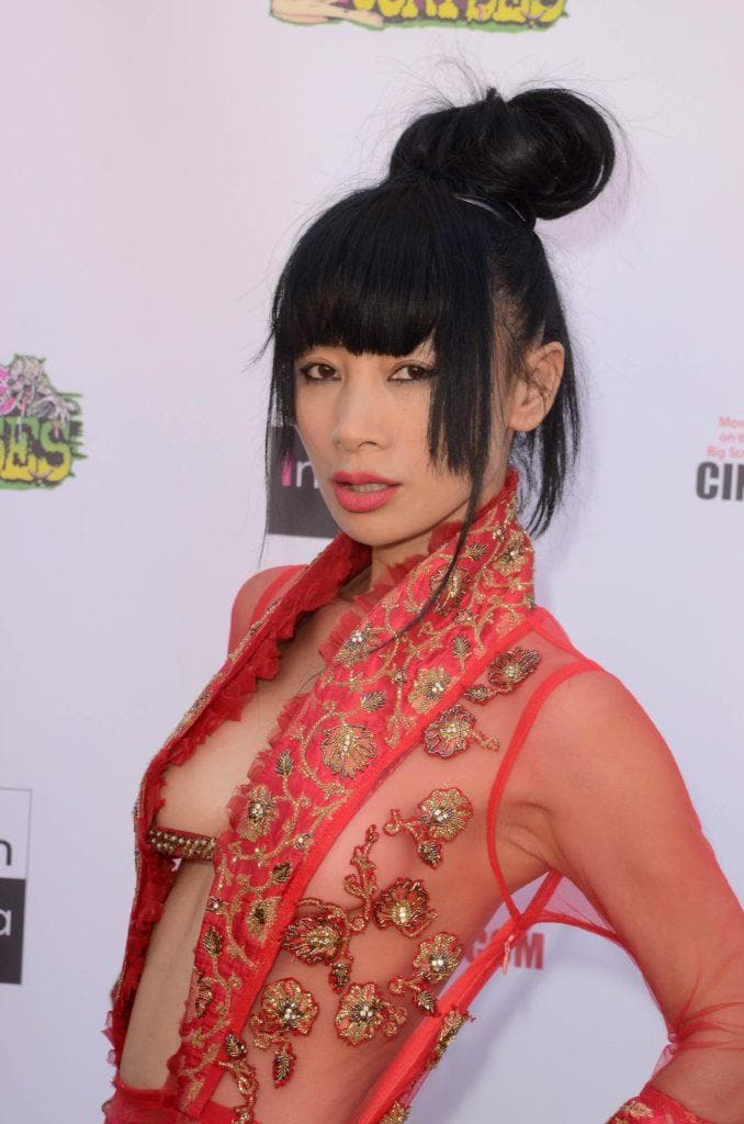 image of Bai Ling with dark hair in a top knot and a full fringe