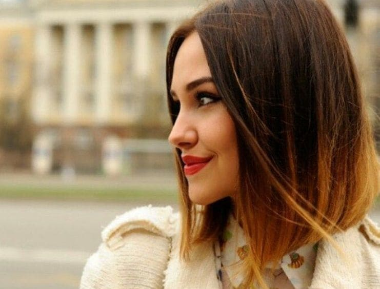 ombre short hair: woman with ginger spiced ombre straight hair wearing red lipstick.
