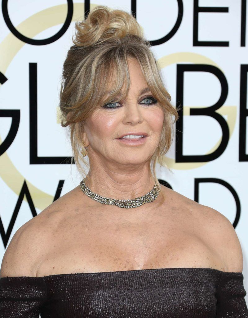 Goldie Hawn fringe updo with blonde highlights