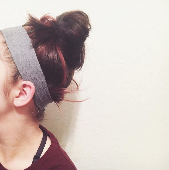 Brunette messy bun with sporty headband