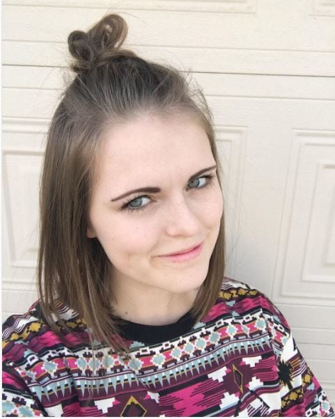 Smiling brunette with half-up topknot