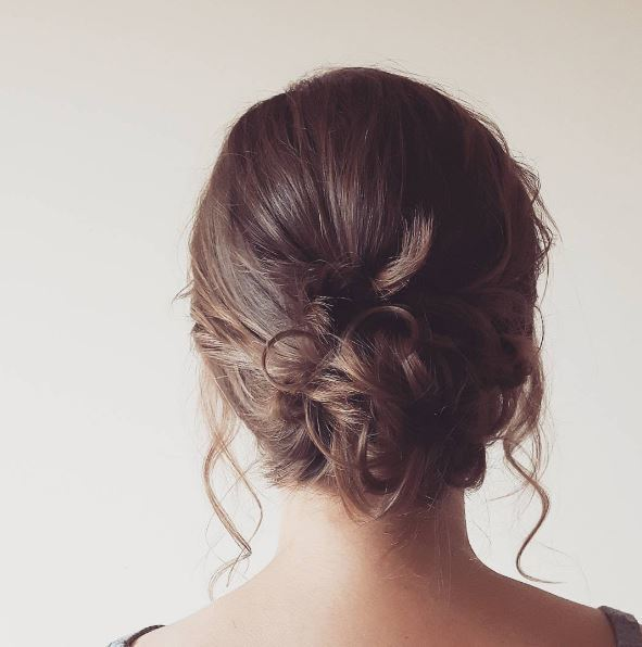Brunette with low bun and tendrils