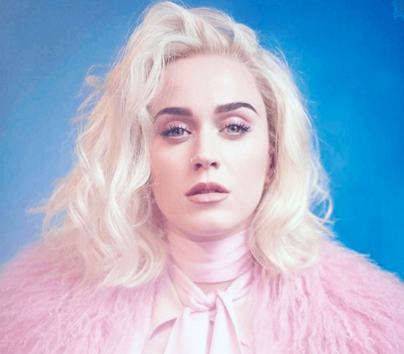 katy perry with platinum blonde wavy bob wearing pink fur coat