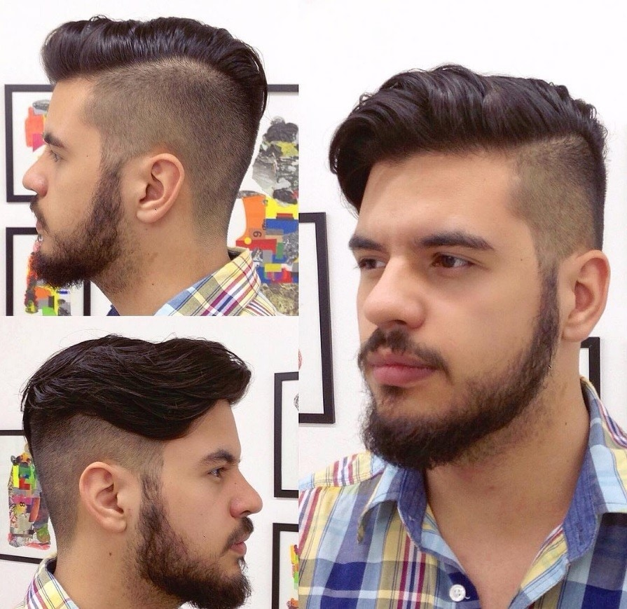 man in plaid shirt with an extreme hair fade